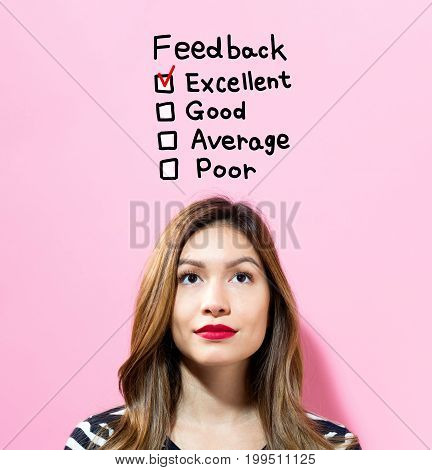 Feedback text with young woman on a pink background