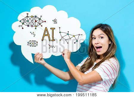 AI text with young woman holding a speech bubble on a blue background