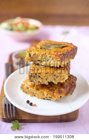 Pieces of vegetable cake with red lentils.