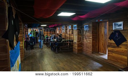 Parque Nacional Cotopaxi, Cotopaxi / Ecuador - August 11 2017: Tourists eating inside the Jose Rivas refuge located at 4800 meters in the volcano Cotopaxi