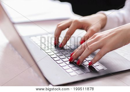 Woman at work with laptop
