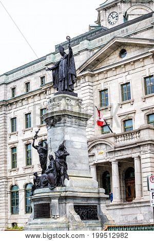 Quebec City Canada - May 30 2017: Old town view of Parks Agency building with Canadian flag and statue of pope