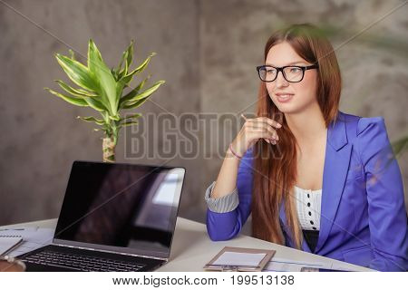 Business. Woman in the office