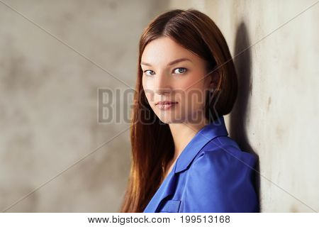 Woman on a concrete wall background