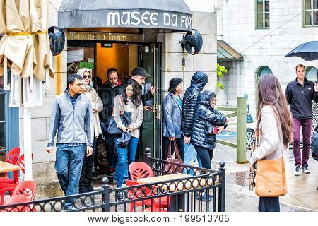 Quebec City, Canada - May 30, 2017: Fort Museum With Tour Group Of People Walking In Heavy Rain With