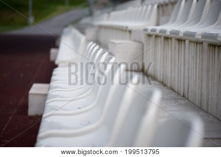 White seats in the stadium fans zone.