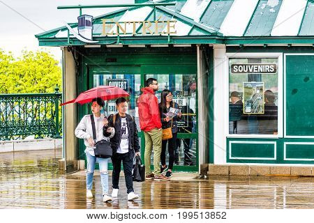Quebec City, Canada - May 30, 2017: Closeup Of Couple Holding Umbrella Walking From Funiculaire In H