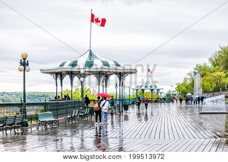Quebec City, Canada - May 30, 2017: Old Town Street And Gazebo On Dufferin Terrace In Heavy Rain Wit