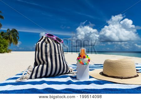 Sunscreen, Hat And Sunglasses On Tropical Beach