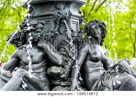 Quebec City Canada - May 30 2017: Large water fountain in summer with greek woman sculpture and parliament building