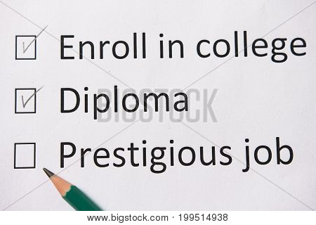 Plan of life: go to college, get diploma, find good job. Words are written on white paper in pencil. Looking for a good job