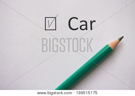 Buy car. The word CAR is written on white paper with a tick and a gray pencil. Implement the plan.