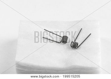 Two Clapton Coil On White Cotton Isolated Background