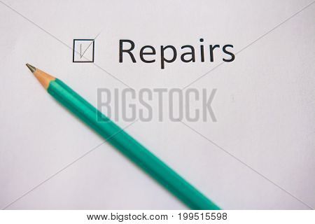 Finish the repair in the house. word REPAIR is written on white paper with tick and gray pencil. Implement the plan.