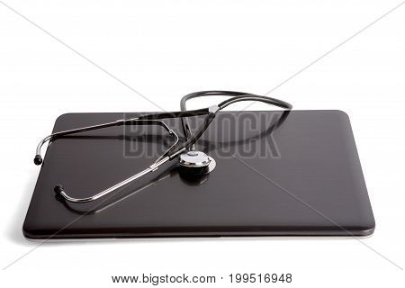 Stethoscope on laptop isolated on white background. Clipping path included.