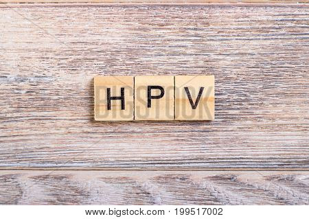HPV Human Papillomavirus acronym on wooden cubes