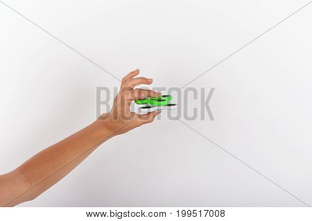 A Hand playing with two fidget spinners