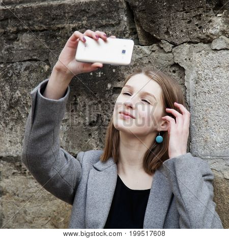 Self-time. Portrait of selfie addict happy young woman.