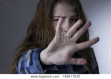 Young beautiful woman showing stop hand sign gesture (Body language gestures psychology)