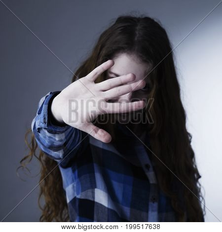 Girl showing stop hand sign gesture (Body language gestures psychology)