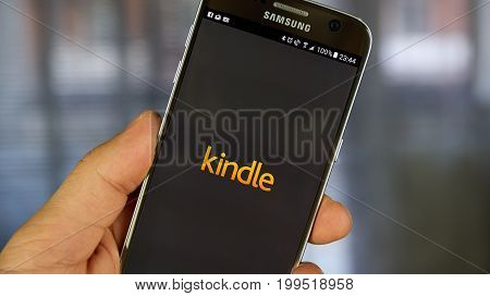 MONTREAL CANADA - APRIL 30 2017 : Kindle android application on a cell phone. The Amazon Kindle is a series of e-readers designed and marketed by Amazon.com