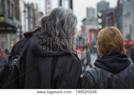 Mature couple urbanism man woman city shallow depth of field