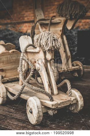 Wooden retro toy handmade horse with wheels and rope traditional joinery craft.