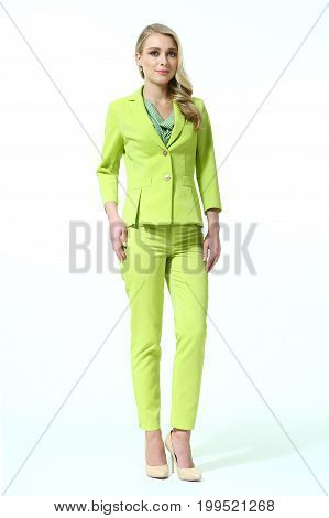 business blond woman in summer green pantsuit full body photo high heels shoes isolated on white