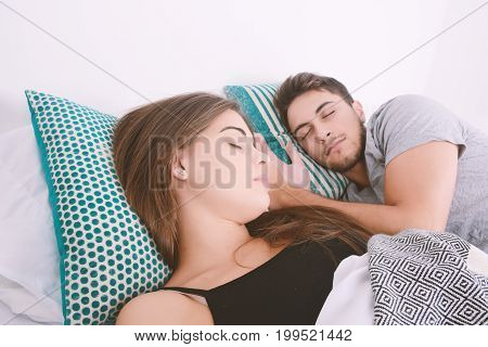 Couple Sleeping In Bed.