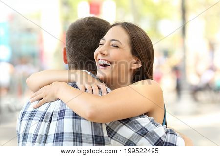 Couple or friends hugging after an encounter