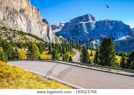 Autumn in the Tirol, Dolomites. Impressive ridge of dolomite rocks. Picturesque highway through the Sella Pass. The concept of ecological and extreme tourism