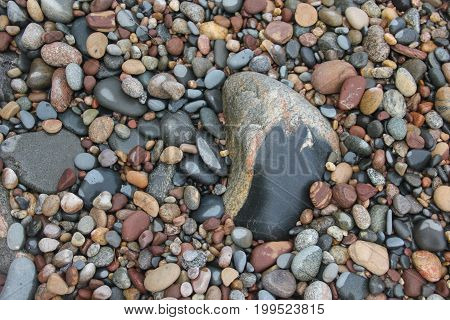 Rock, stones and pebbles on the beach of Lake Superior.   Pictured Rocks National Lakeshore, Upper Peninsula of Michigan