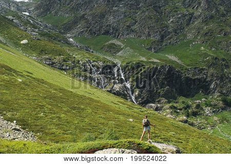 Beauty young woman travel with backpack in mountain