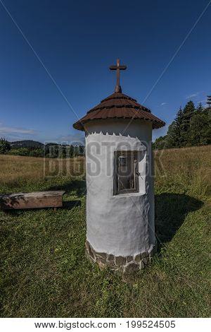 White small chapel near Velke Karlovice village in summer morning