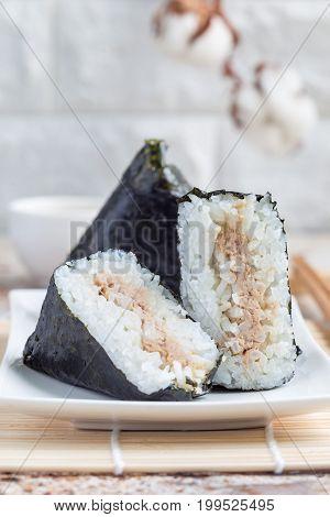 Korean triangle kimbap Samgak made with nori rice and tuna fish similar to Japanese rice ball onigiri. Vertical copy space