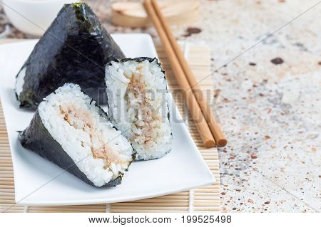 Korean triangle kimbap Samgak made with nori rice and tuna fish similar to Japanese rice ball onigiri. Horizontal copy space