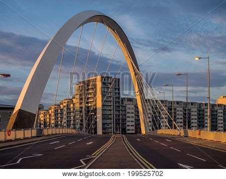 GLASGOW, SCOTLAND - JULY 21: The River Clyde with the Clyde Arc Bridge on July 21, 2017 in Glasgow, Scotland. Glaswegians call the Clyde Arc the squinty bridge due to its meandering path across.