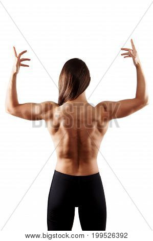 Young woman bodybuilder showing muscular body isolated on white background