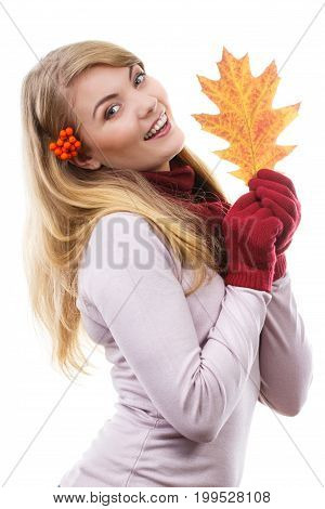 Happy Smiling Girl With Rowan In Hair Wearing Woolen Gloves And Holding Autumnal Leaf