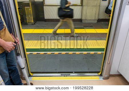 TOKYO, JAPAN - JUNE 18 2017 : Inside the train while door open (Tokyo Metro) with passenger