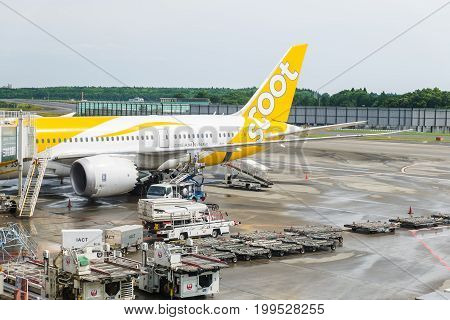 TOKYO, JAPAN - JUNE 18 2017 : Scoot Airlines Boeing 787 waiting for boarding passenger from terminal at narita international airport