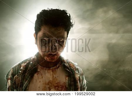 Scary zombie in dark room with smoke