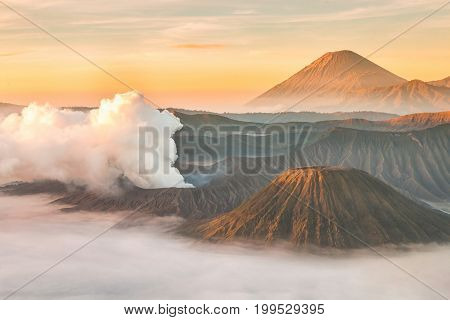 Landscape of Mount Bromo volcano Batok and Semeru (Mt.) during sunrise from viewpoint on Mount Penanjakan located in Bromo Tengger Semeru National Park East Java Indonesia.