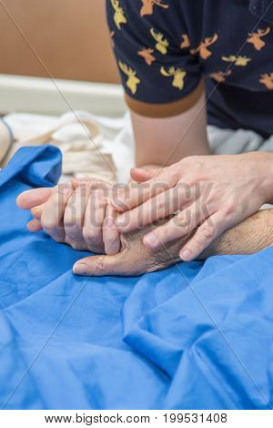 Patient In The Hospital And Holding A Hand