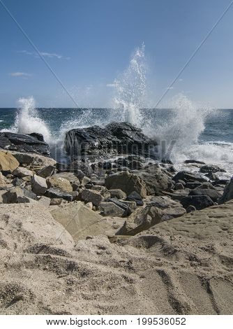 Waves crashing over rocks at Thornhill Broom beach in California