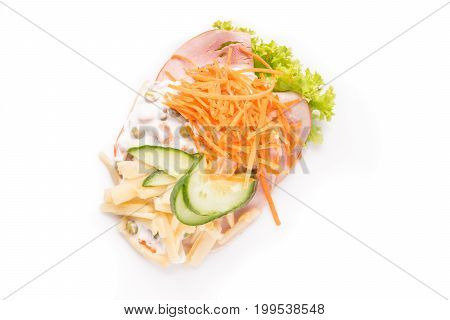 Danish specialties and national dishes high-quality open sandwich. Sandwich with sliced ham Mayonnaise with green peas and carrot tart cracked carrots asparagus and cucumbers
