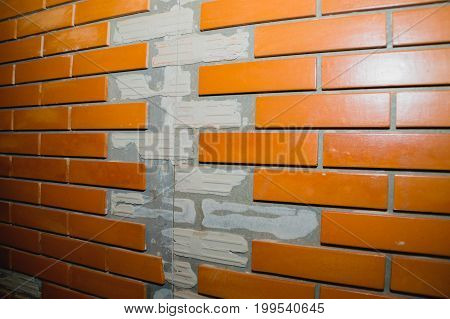 red brick wall texture grunge background with vignetted corners may use to interior design