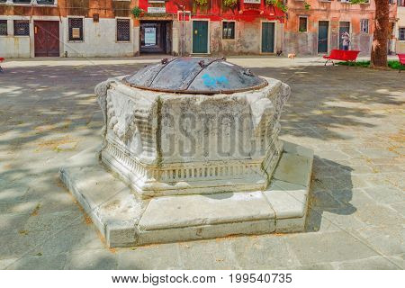 Venice, Italy - May 12, 2017 : Water Intake Facilities Medieval Venetian Wells In The City Squares.