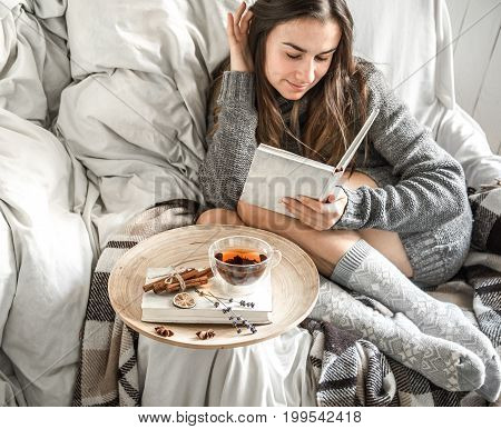 The Girl On The Couch With Tea And A Book