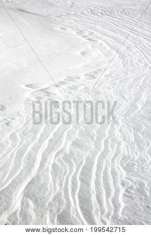 Wind-blown patterns of snow in winter weather